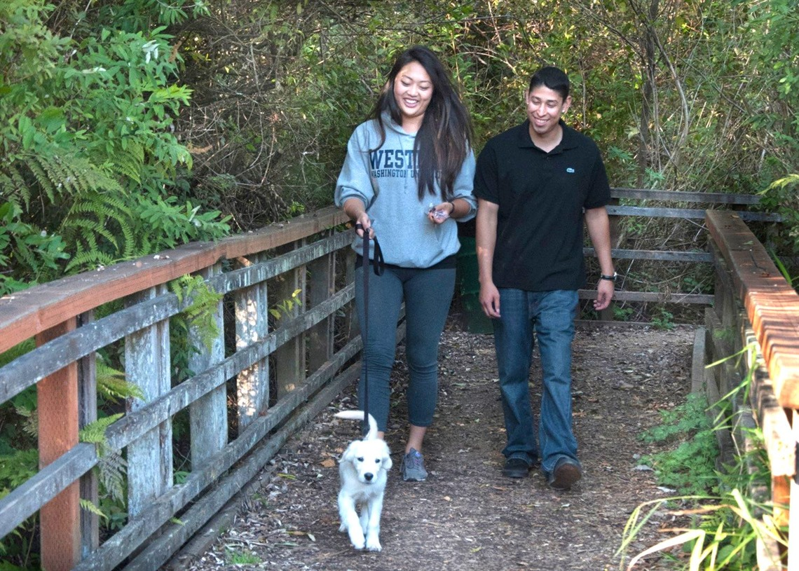 Couple walking a dog at Scriber Lake Park